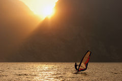 Surfing Sunset Wind Sport. Young man surfing the wind during sunset Royalty Free Stock Photos