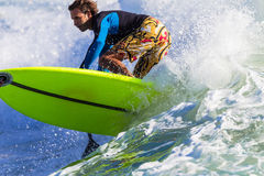 Surfing SUP Close-Up. Male rider surfing SUP board at Durban beachs.Close photo image of action Stock Photo