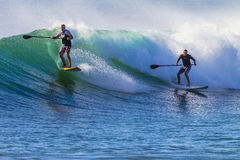 Surfers SUP Ridng Wave. Surfing SUP boards at Durban beachs Photo image of two riders surfing a morning wave Royalty Free Stock Photos