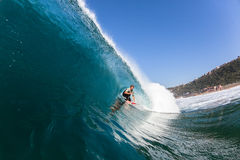Surfing surfer Hollow Blue Ocean Wave Stock Images