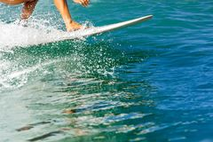 Surfing time for sporty lady. stock photo