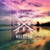 Surfing typographic design on blurred photo Royalty Free Stock Photo