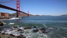 Surfing under Golden Gate Bridge stock video footage