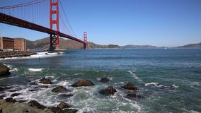 Surfing under Golden Gate Bridge. View at Golden Gate Bridge- San Francisco, California stock video footage