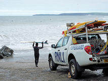 Surfing under safety supervision Stock Photo