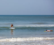 Surfing in Varkala Royalty Free Stock Image