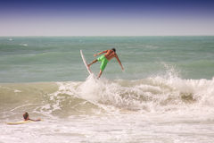 Surfing. Surfing the water and jump in the air Stock Photo