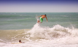 Surfing. Surfing the water and jump in the air Stock Images