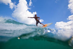 Surfing a wave. Surfer ride a bali wave royalty free stock photos