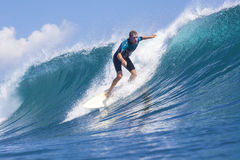 Surfing a wave Royalty Free Stock Photography