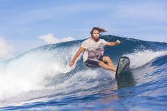 Surfing a wave Royalty Free Stock Photo