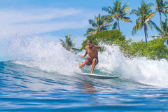 Surfing a Wave. Bali Island. Indonesia. Royalty Free Stock Photography