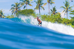Surfing a Wave. Bali Island. Indonesia. Stock Photo