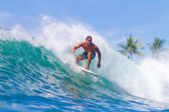Surfing a Wave. Bali Island. Indonesia. Picture of Surfing a Wave. Bali Island. Indonesia stock image