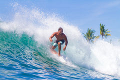 Surfing a Wave. Bali Island. Indonesia. stock images