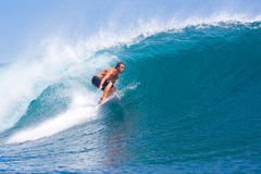 Surfing a Wave.GLand Surf Area.Indonesia. Royalty Free Stock Photo