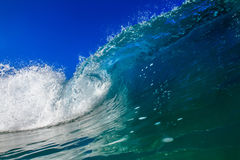 Surfing Wave in Maldives. Shorebreak Big ocean wave in daylight. Beautiful sky with clouds. Sea Water surface for surfing sport. Nobody on picture. Vibrant stock photography