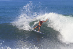 Surfing a Wave. Picture of Surfing a Wave.Bali Island. Indonesia Royalty Free Stock Image