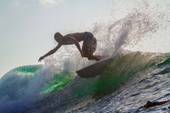 Surfing a Wave. Stock Photo