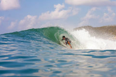 Surfing a Wave. Picture of the Surfer in the Ocean.Lombok Island.Indonesia Stock Photography