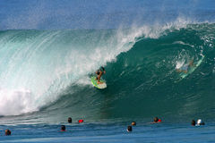 Surfing a Wave at Pipeline stock image