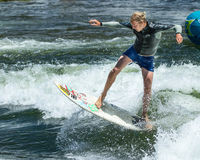 Surfing a wave in the river Stock Photos
