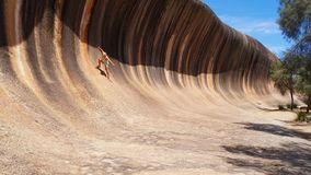 Surfing Wave Rock - Western Australia royalty free stock photography