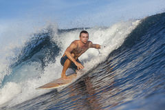 Surfing a wave Royalty Free Stock Image