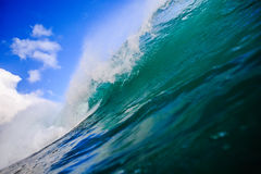 Surfing Wave in Tahiti. Ocean Background Big Shorebreak Wave for Surfing. Swell for sport activity. Power and Energy Of Nature royalty free stock photo