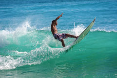 Surfing the waves Stock Photo