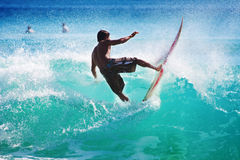 Surfing the waves Royalty Free Stock Photos