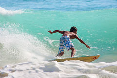 Surfing the waves Royalty Free Stock Photography