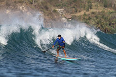 Surfing the Waves Stock Photography