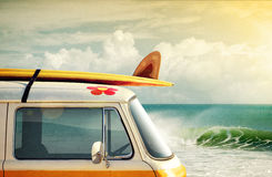 Surfing Way of Life. Idyllic surfing way of life with a van and long board near the sea Royalty Free Stock Image
