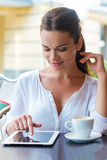 Surfing web in cafe. Royalty Free Stock Photography