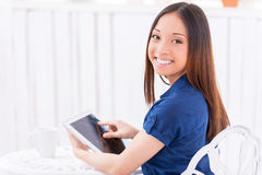 Surfing web in cafe. Royalty Free Stock Image