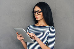Surfing web on her new tablet. Royalty Free Stock Images