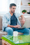 Surfing web at home. Stock Image
