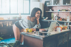 Surfing web from kitchen. Stock Photos