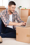 Surfing web in a new house. Royalty Free Stock Photo