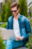 Surfing web outdoors. Royalty Free Stock Photos