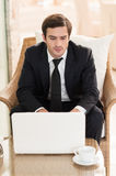 Surfing web in restaurant. Stock Images