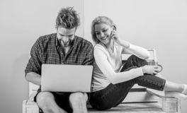 Surfing web together. Couple cheerful spend leisure with laptop surfing web watch video. Couple in love relaxing surfing royalty free stock photo