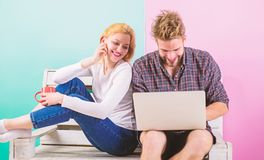 Surfing web together. Couple cheerful spend leisure with laptop surfing web watch video. Couple in love relaxing surfing stock photography