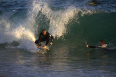 Surfing The Wedge Stock Photo