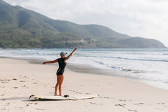 Surfing woman with surfing board on the beach Royalty Free Stock Photos
