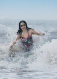 Surfing woman Stock Images