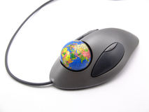Surfing......with the world. A funny picture of a trackball containing a globe as ball. Representing the control over the word wide web with the mouse. Can also Royalty Free Stock Photo