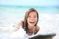 Surfing young woman in waves - enjoying, playing Royalty Free Stock Photography