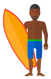 Surfista que guarda a prancha Imagens de Stock Royalty Free